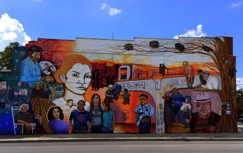 San Antonio's impoverished West side has a vibrant mural scene, as depicted on the side of this building and many others.