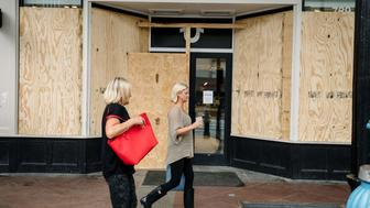 Shops and businesses have boarded up their store fronts in the French Quarter in preparation for Hurricane Nate in New Orleans on October 07 2017. Residents in three states along the US Gulf Coast scrambled to complete preparations Saturday ahead of Hurricane Nate as officials warned conditions would turn treacherous after sunset. Nate was forecast to arrive late Saturday as a Category Two hurricane, packing winds topping 90 miles per hour as it churned in the Gulf of Mexico. The storm killed at least 28 people in Central America.   / AFP PHOTO / Bryan Tarnowski        (Photo credit should read BRYAN TARNOWSKI/AFP/Getty Images)
