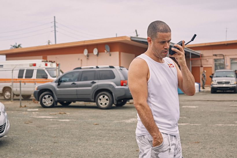 Crazy Legs talks on a satellite phone at the Rafael Hernández Airport in Aguadilla, Puerto Rico on September 30, 2017