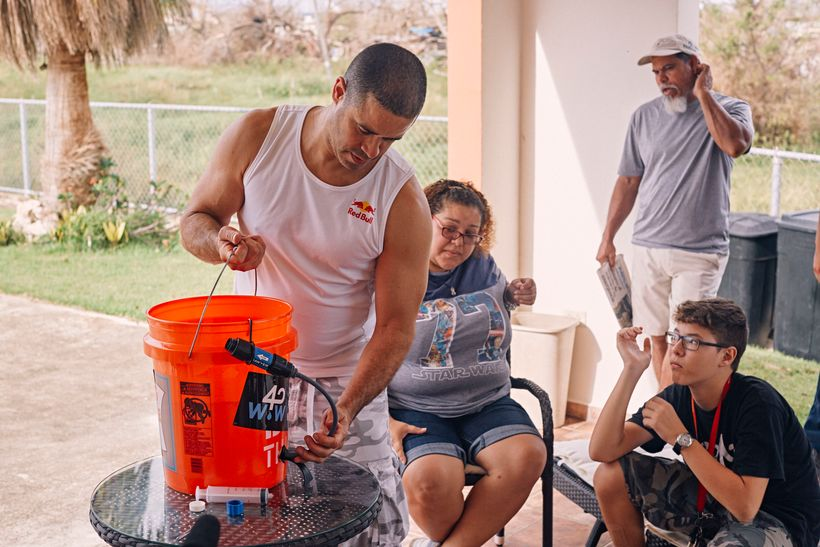 Crazy Legs demonstrates how to assemble a water filtration system at his home in Isabela, Puerto Rico on September 30, 2017