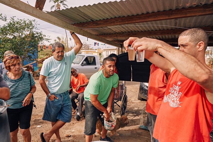 Crazy Legs shows the results of the water filtration system to his neighbors in Isabela, Puerto Rico on October 1, 2017.