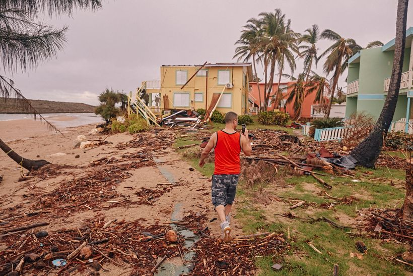 Crazy Legs photographs ravaged bungalows of the Villas del Mar Hau Hotel on the Montones Beach in Isabela, Puerto Rico on Sep
