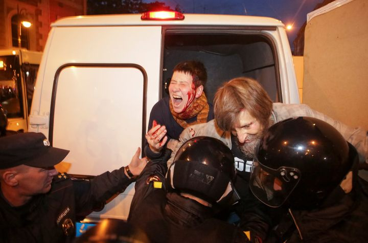 Police officers detain supporters of Russian opposition leader Alexei Navalny during a rally in St. Petersburg, Russia Octobe