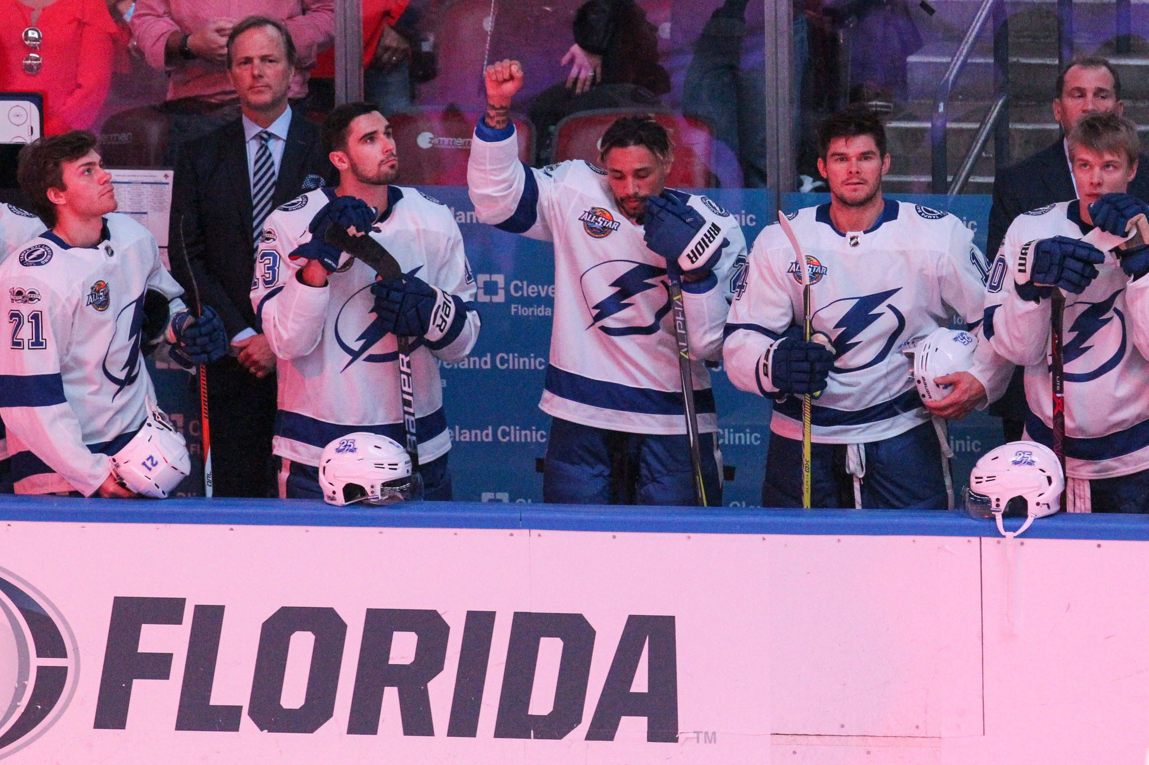 The Tampa Bay Lightning's J.T. Brown protests during the national anthem before the start of a game against the Florida Panth