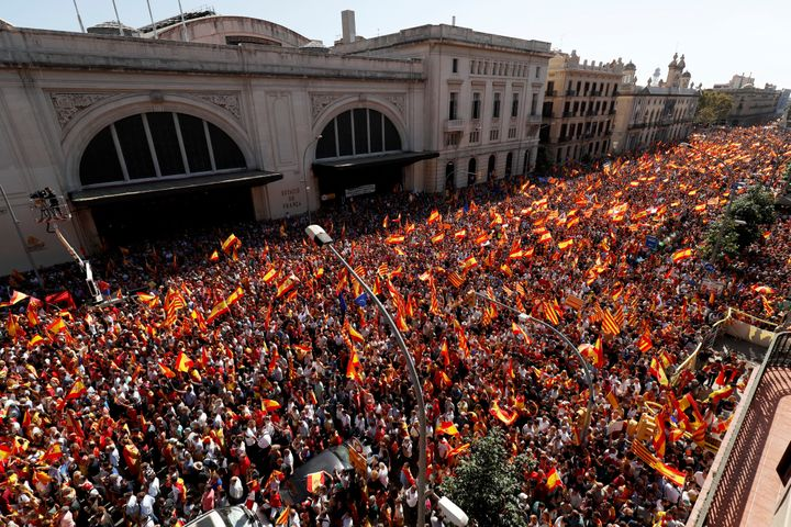 A pro-union demonstration organised by the Catalan Civil Society organisation makes its way through the streets of Barcelona,