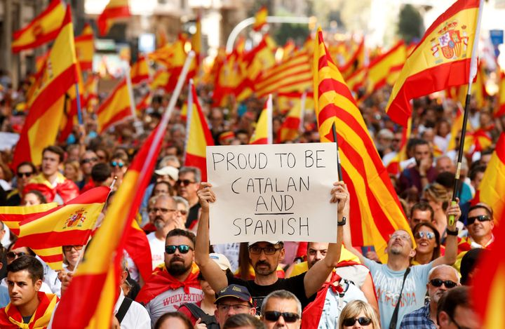 A man holds up a sign while attending a pro-union demonstration organised by the Catalan Civil Society organisation in Barcel