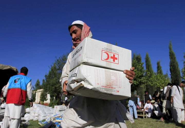 Attacks on Red Cross workers has prompted the humanitarian organization to cut back on services in Afghanistan.