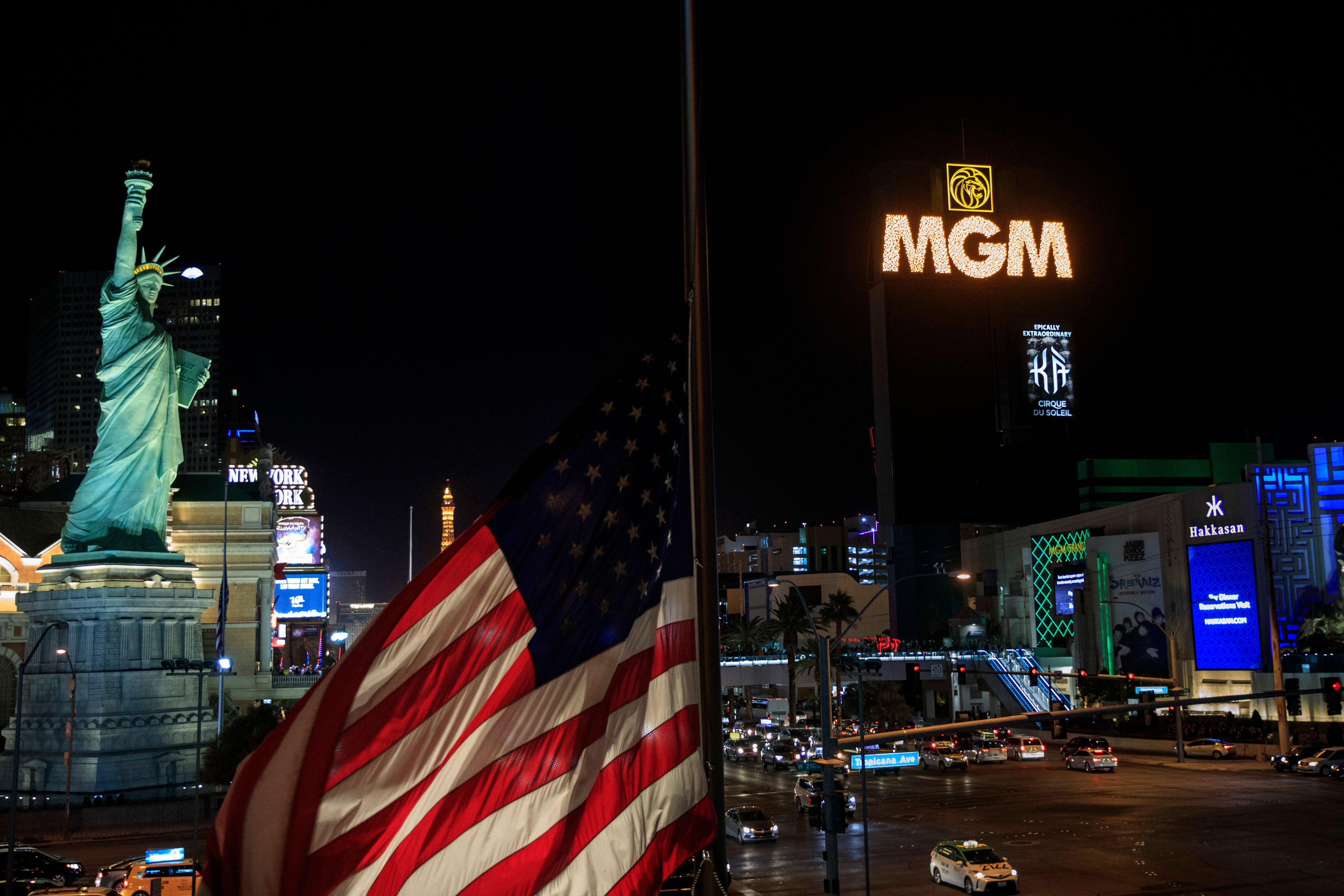 LAS VEGAS, NV - OCTOBER 8: The marquees on the Las Vegas Strip, including the marquee of MGM Grand Hotel & Casino (R), go dark for 11 minutes in tribute to the victims of the Route 91 Harvest country music festival, on October 8, 2017 in Las Vegas, Nevada. On October 1, Stephen Paddock killed 58 people and injured more than 450 after he opened fire on a large crowd at the Route 91 Harvest country music festival. The massacre is one of the deadliest mass shooting events in U.S. history. (Photo by Drew Angerer/Getty Images)