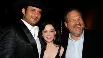 CANNES, FRANCE - MAY 25:  Director Robert Rodriguez, actress Rose McGowan and producer Harvey Weinstein attend The Chopard Trophy held at the Rosarie Club during the 60th International Cannes Film Festival May 25 2007 in Cannes, France.  (Photo by Michel Dufour/WireImage)