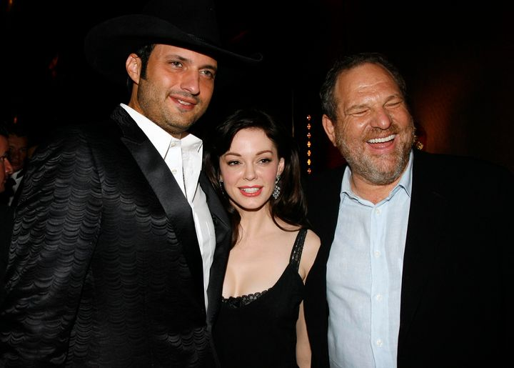 <br> Rose McGowan (center) poses with director and then-boyfriend Robert Rodriguez (left) and Harvey Weinstein (right) in 200