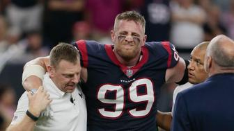 HOUSTON, TX - OCTOBER 08:  J.J. Watt #99 of the Houston Texans is helped off the field after being injured in the first quarter against the Kansas City Chiefs at NRG Stadium on October 8, 2017 in Houston, Texas.  (Photo by Bob Levey/Getty Images)