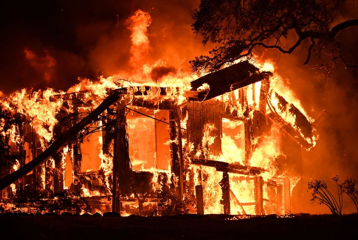 Flames ravage a home in the Napa wine region in California on October 9, 2017, as multiple wind-driven fires continue to whip