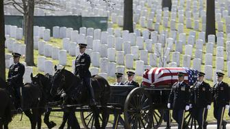 The caisson and casket are seen in procession before a burial service for U.S. Army Sergeant First Class Matthew McClintock, who was killed in action in Afghanistan in January, at Arlington National Cemetery in Virginia March 7, 2016.      REUTERS/Gary Cameron
