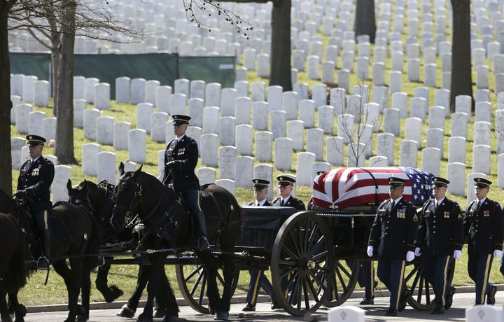 The caisson and casket are seen in procession before a burial service for U.S. Army Sergeant First Class Matthew McClintock,