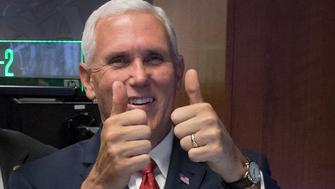 HUNTSVILLE, AL - SEPTEMBER 25: In this handout provided by NASA, Vice President Mike Pence, right, gives a thumbs up to the control room team after he talked with Expedition 53 crew members Joe Acaba, Randy Bresnik, and Mark Vande Hei onboard the International Space Station, while Rep. Robert Aderholt, (R-AL) and Marshall Space Flight Center International Space Station Payload Communications Manager Jessica Duckworth look on at the NASA Marshall Space Flight Center on September 25, 2017 in Huntsville, Alabama.  The Vice President visited the space center to view test hardware for NASA's Space Launch System, America's new deep space rocket and to call the crew onboard the International Space Station. (Photo by Bill Ingalls/NASA via Getty Images)