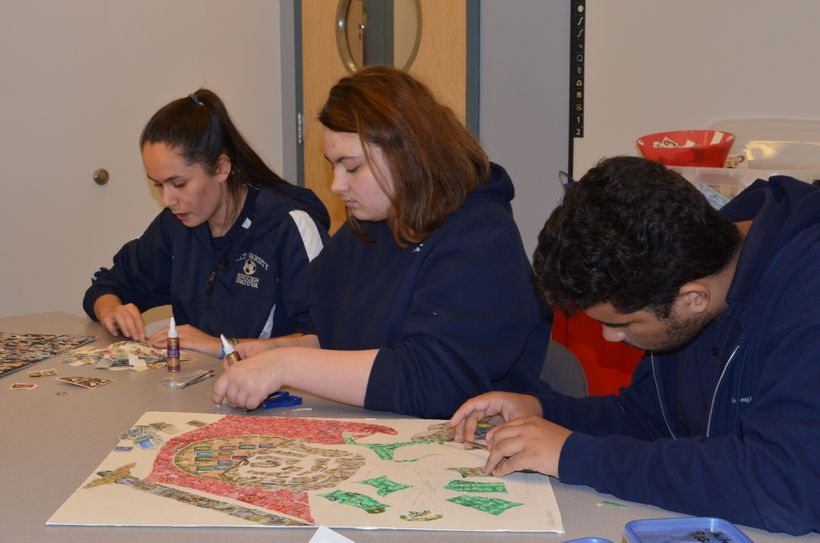 Foxborough Regional Charter School High school students selecting stamps  to use on two Holocaust Stamp Project stamps collag