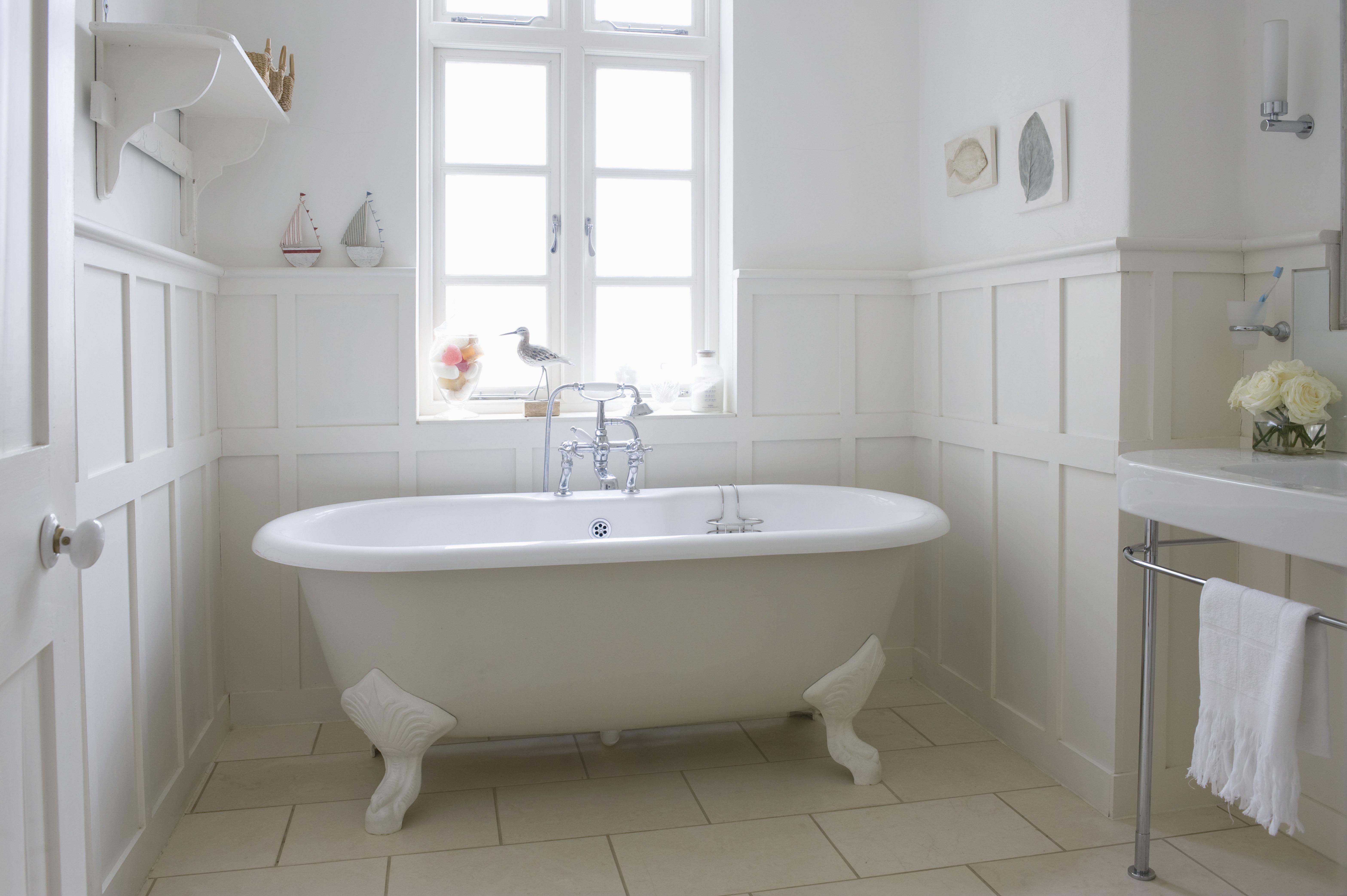 Freestanding bathtub in bathroom