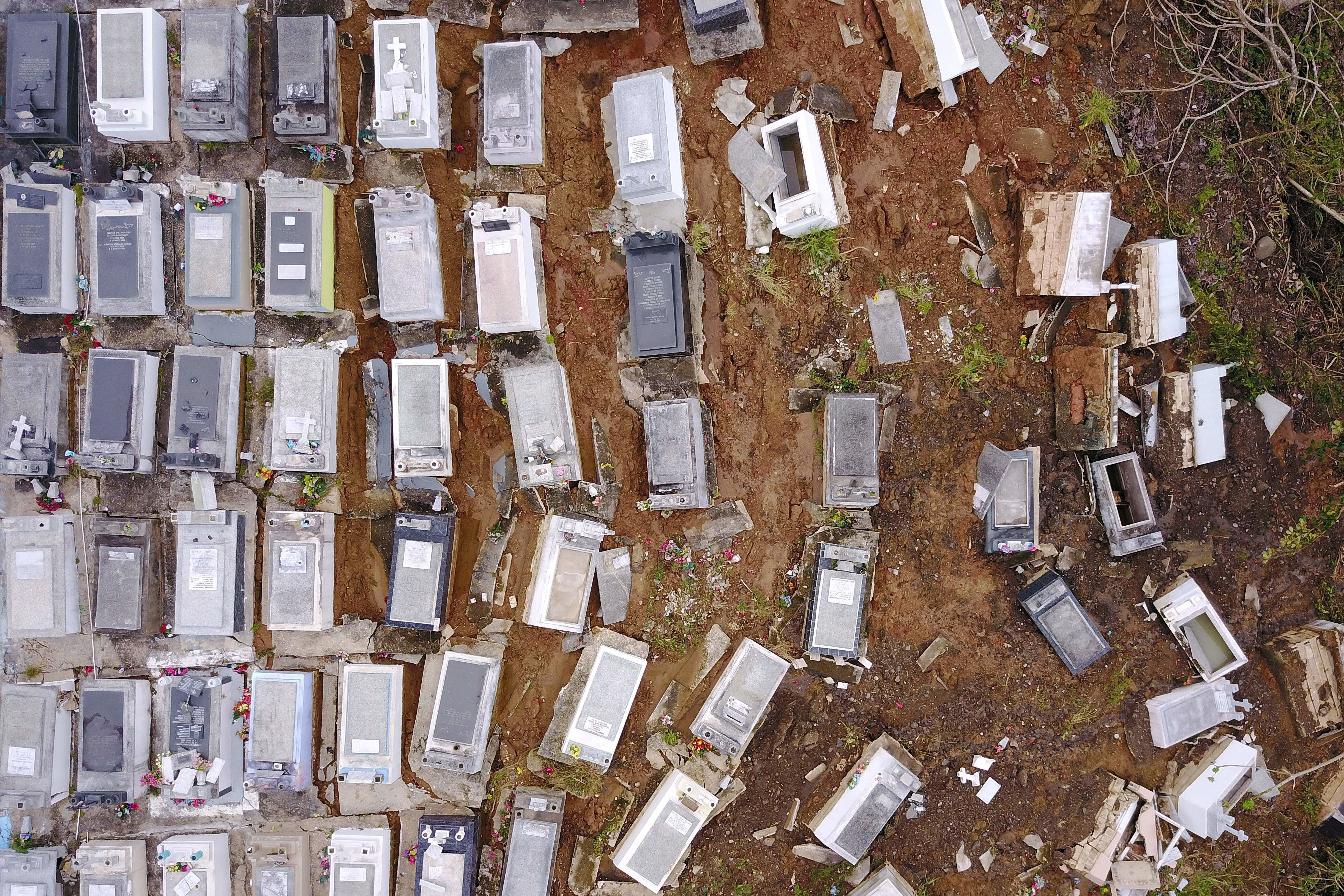 Coffins were washed downhill from the Lares Municipal Cemetery by a landslide in the wake of Hurricane...
