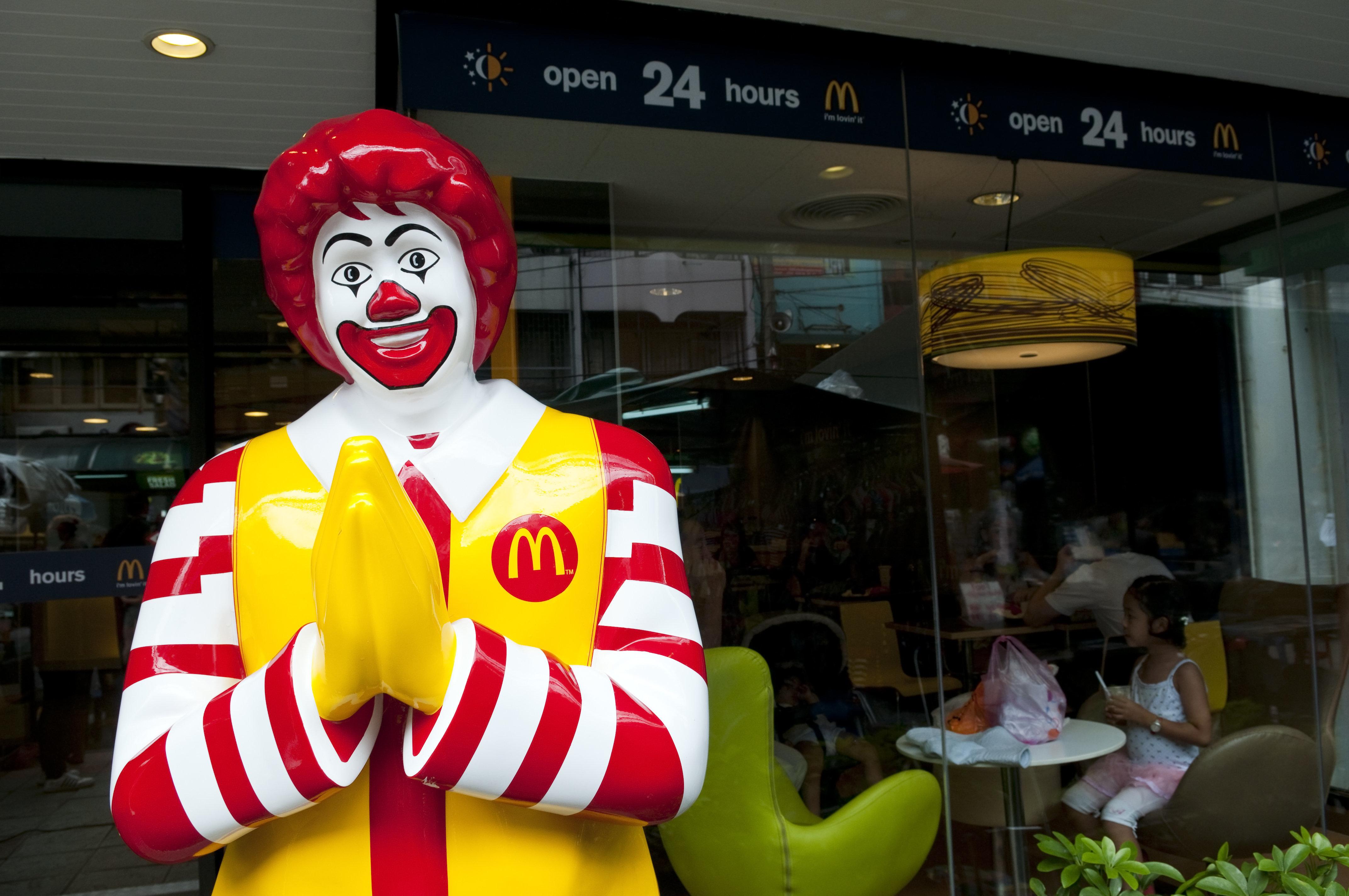 Bangkok, Thailand - September 24, 2011: Ronald McDonald performs a Thai wai greeting outside a 24-hour McDonalds restaurant on Khao San Road.