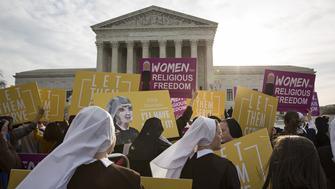 Nuns, who are opposed to the Affordable Care Act's contraception mandate, and other supporters rally outside of the Supreme Court in Washington, D.C., U.S., on Wednesday, March 23, 2016. On Wednesday morning, the Supreme Court is scheduled to hear oral arguments in Zubik v. Burwell, a consolidated case brought by religious groups challenging a process for opting out of the Affordable Care Act's contraception mandate. Photographer: Drew Angerer/Bloomberg via Getty Images