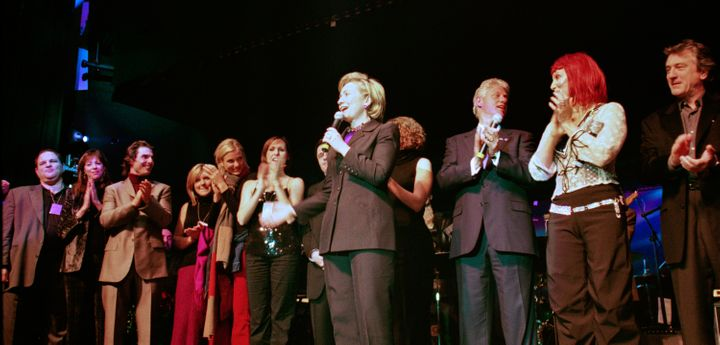 Hillary Clinton surrounded by family and celebrities during her 53rd birthday celebration in 2000.