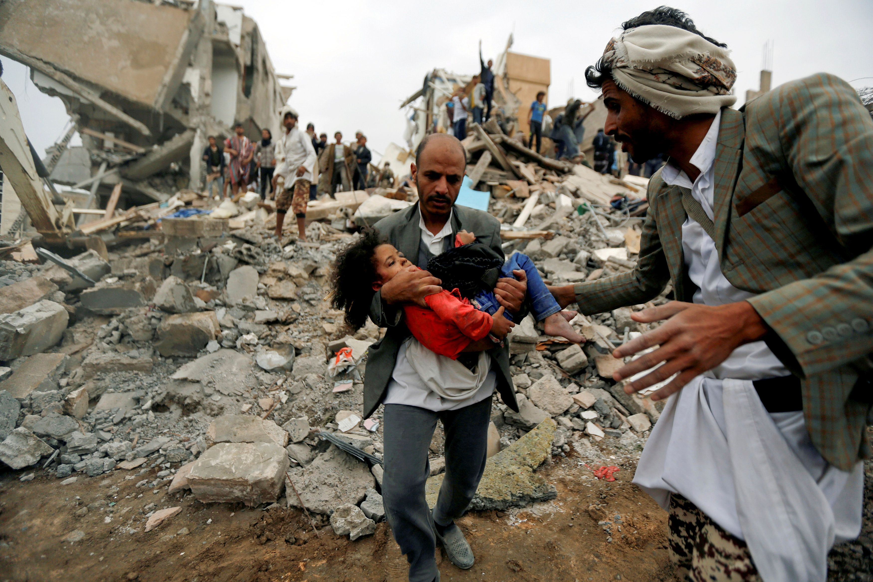 "A man carries Buthaina Muhammad Mansour, believed to be four or five, rescued from the site of a Saudi-led air strike that killed eight of her family members in Sanaa, Yemen August 25, 2017.  REUTERS/Khaled Abdullah/File Photo SEARCH ""STRIKE MANSOUR"" FOR THIS STORY. SEARCH ""WIDER IMAGE"" FOR ALL STORIES. TPX IMAGES OF THE DAY"