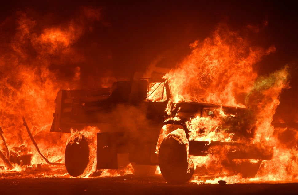 A truck is totally consumed by flames.