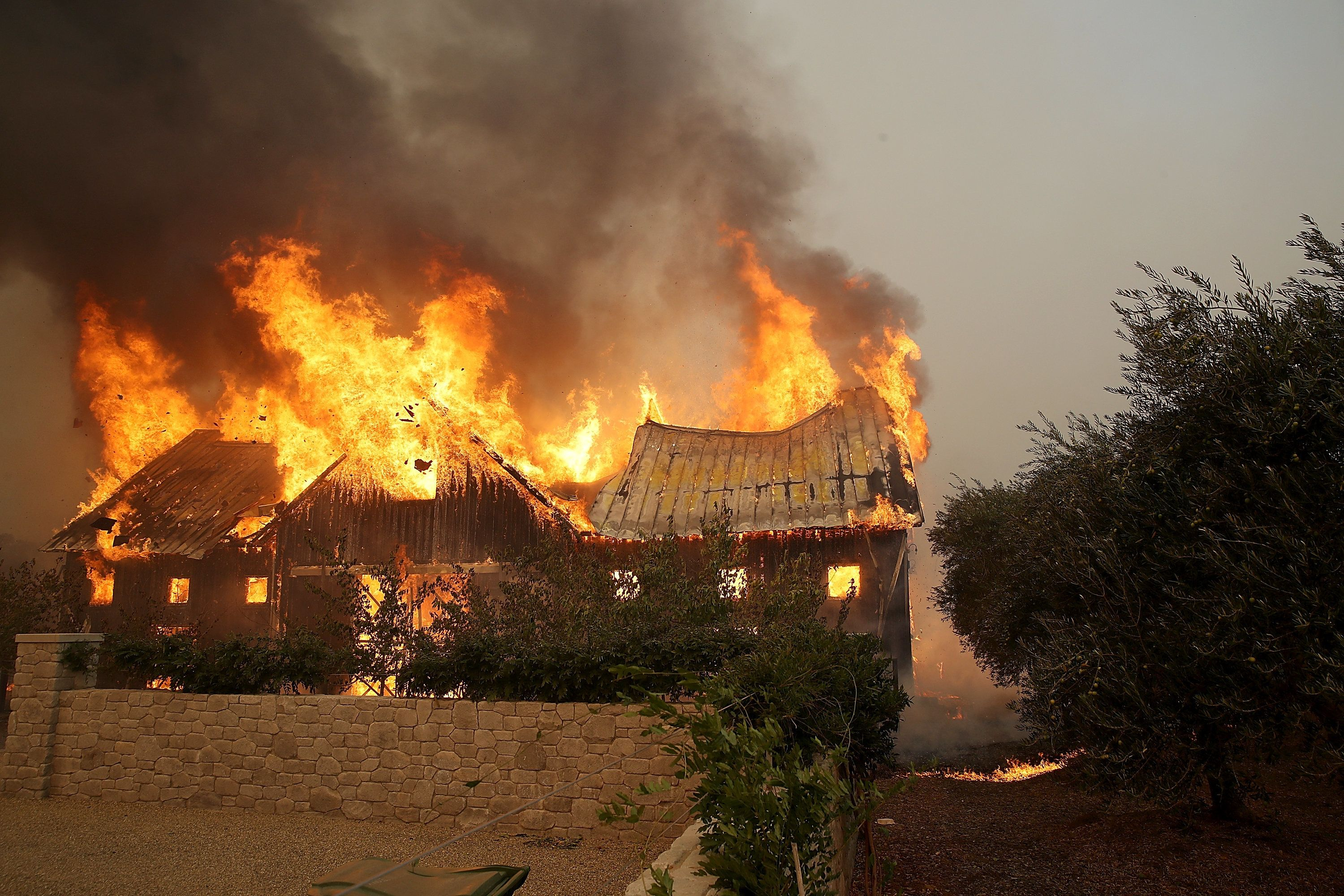 GLEN ELLEN, CA - OCTOBER 09:  Fire consumes a barn as an out of control wildfire moves through the area on October 9, 2017 in Glen Ellen, California. Tens of thousands of acres and dozens of homes and businesses have burned in widespread wildfires that are burning in Napa and Sonoma counties.  (Photo by Justin Sullivan/Getty Images)