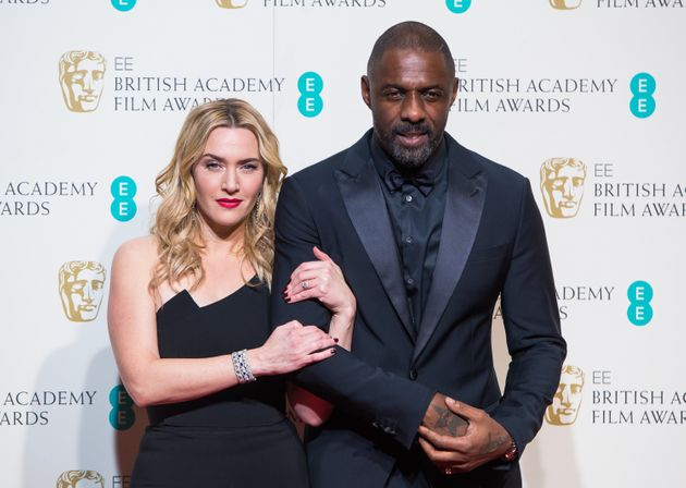 Kate Winslet and Idris Elba pose in the winners room at the EE British Academy Film Awards at The Royal...
