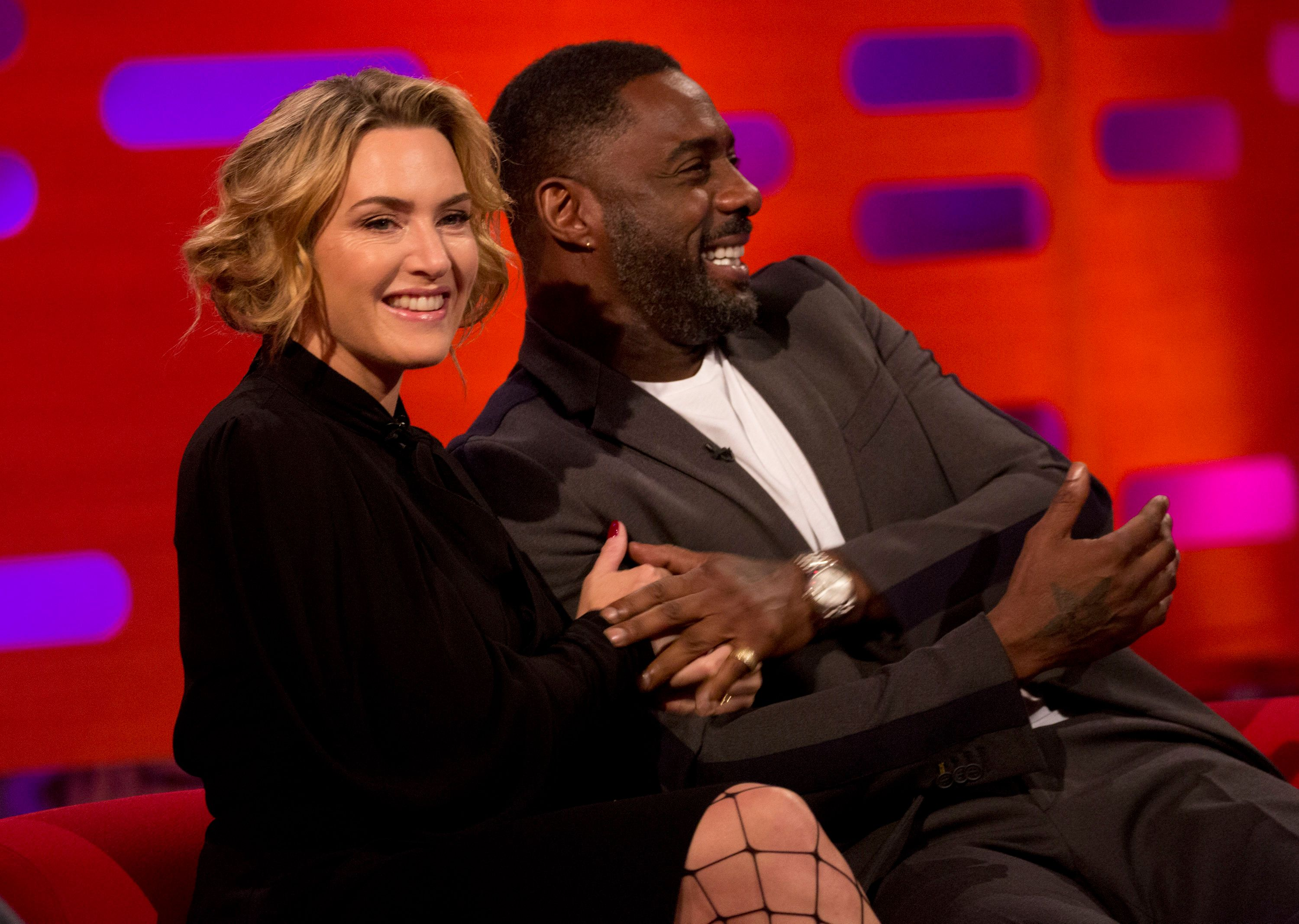 Kate Winslet and Idris Elba during filming of the Graham Norton Show at the London Studios, to be aired on BBC One on Friday evening. (Photo by Isabel Infantes/PA Images via Getty Images)