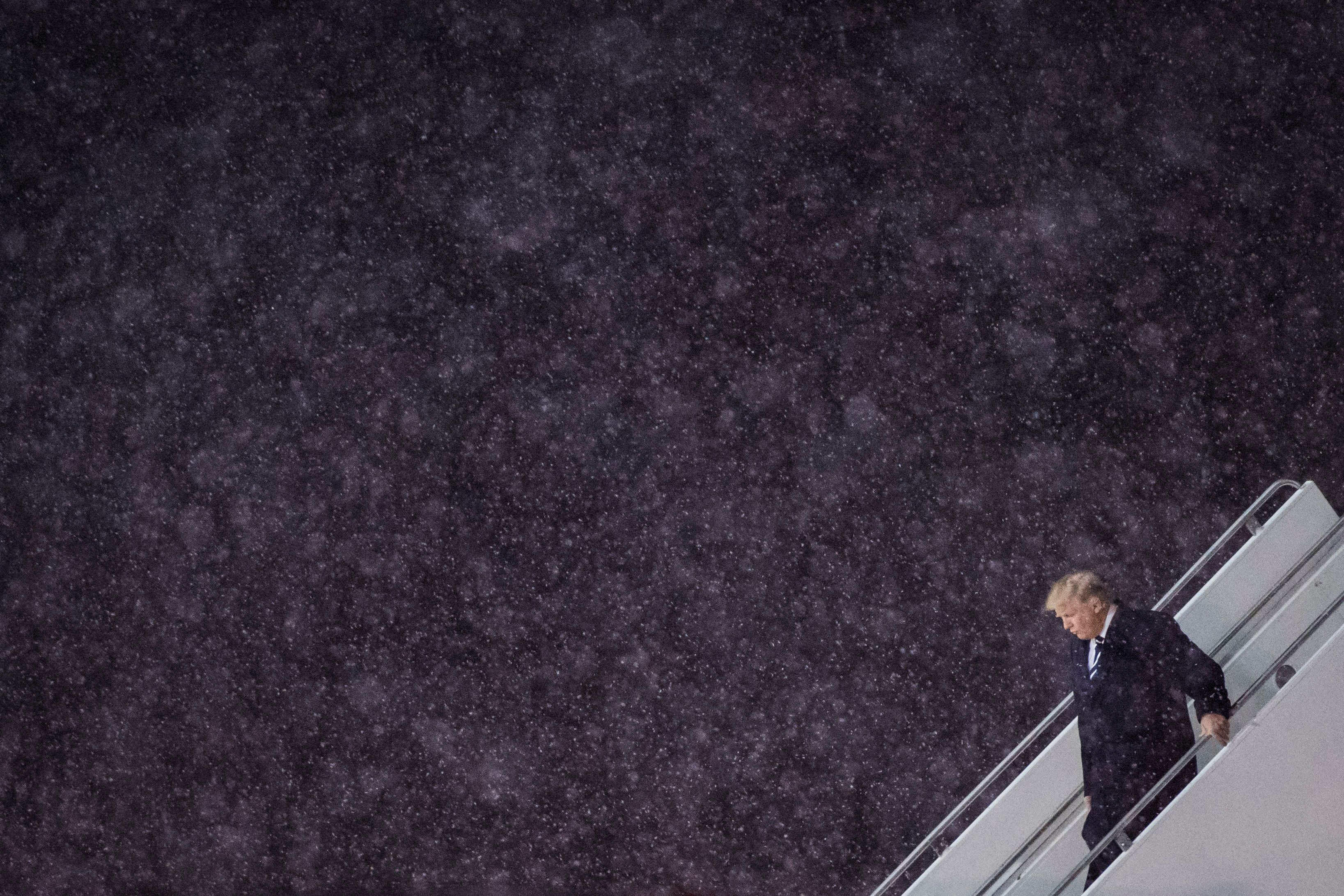 GRAND RAPIDS, MI - DECEMBER 9: President-Elect Donald J. Trump disembarks his plane in the snow as he makes his way to a 'USA Thank You Tour 2016' event at the DeltaPlex in Grand Rapids, Mi. on Friday, Dec. 09, 2016. (Photo by Jabin Botsford/The Washington Post via Getty Images)