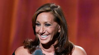 Designer Donna Karan speaks at the Clinton Global Citizen Awards, held during the second day of the Clinton Global Initiative 2012 (CGI) in New York, September 24, 2012. The CGI, which runs through September 25, was created by former U.S. President Bill Clinton in 2005 to gather global leaders to discuss solutions to the world's problems. REUTERS/Andrew Burton (UNITED STATES - Tags: FASHION POLITICS BUSINESS)