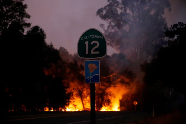 Smoke and flames rise as a wildfire from California's Santa Rosa and Napa Valley moves through the area...