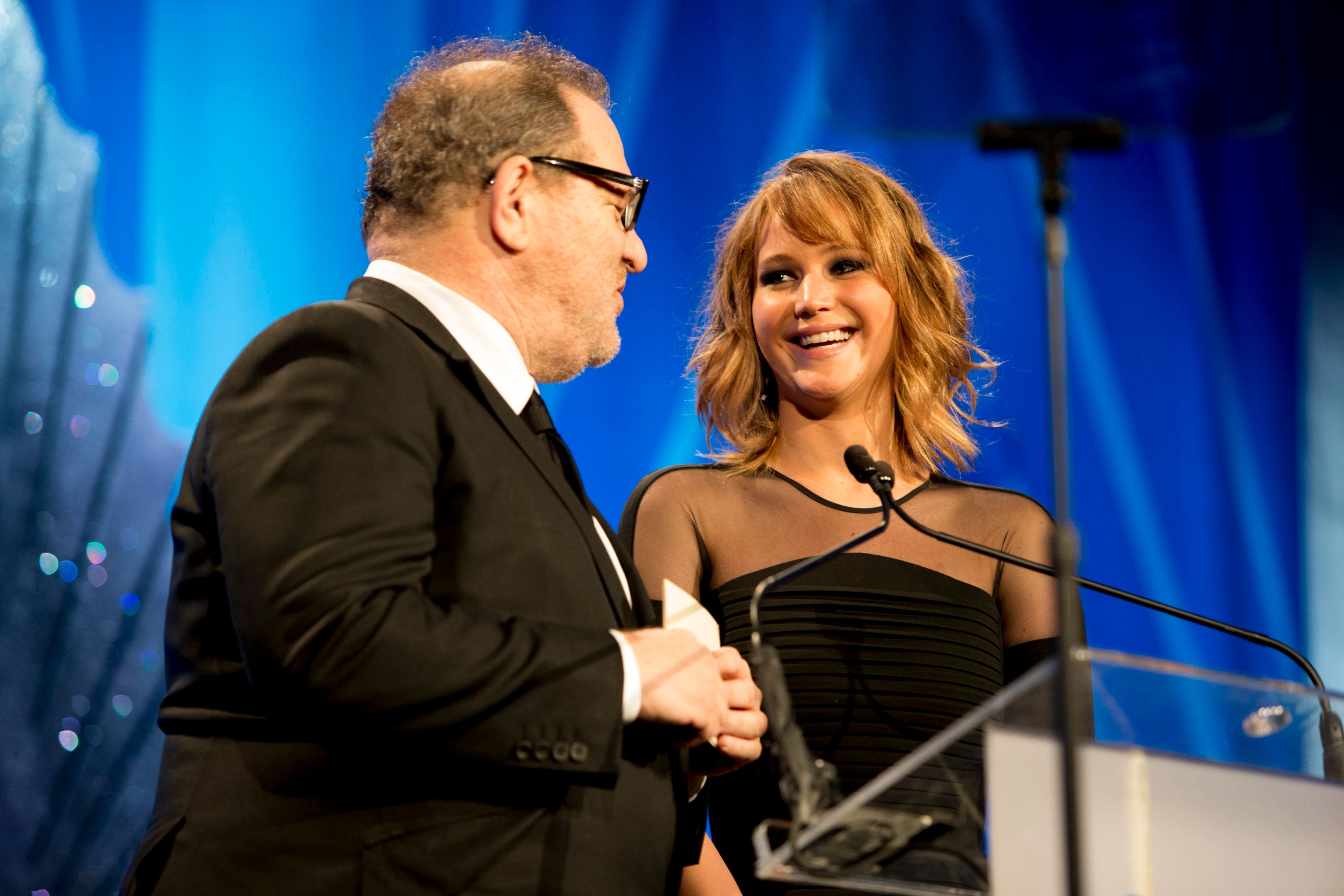 Jennifer Lawrence and Harvey Weinstein appear onstage during 2013's GLAAD Media Awards.