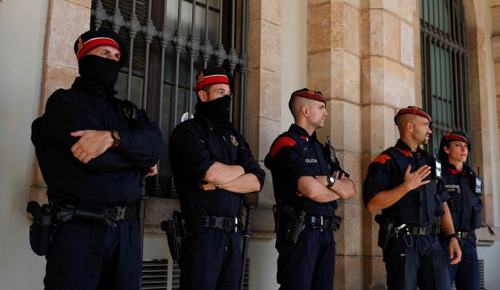 Mossos d'Esquadra, Catalan regional police officers, stand guard outside the Catalonian regional parliament in Barcelona, Spa