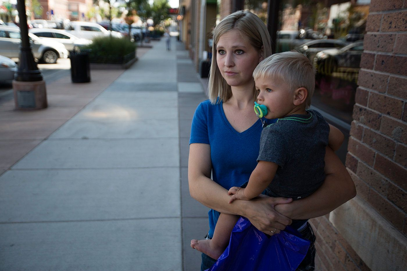 Marlayna Walker holds her 18-month-old son, Zeke, in downtown Gillette, Wyoming. While she has opinions on hot-button social
