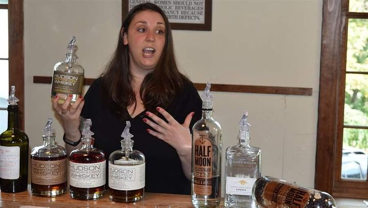 Employee Laura McGinley shows farm-distilled liquors at Tuthilltown Spirits in Gardiner, New York.
