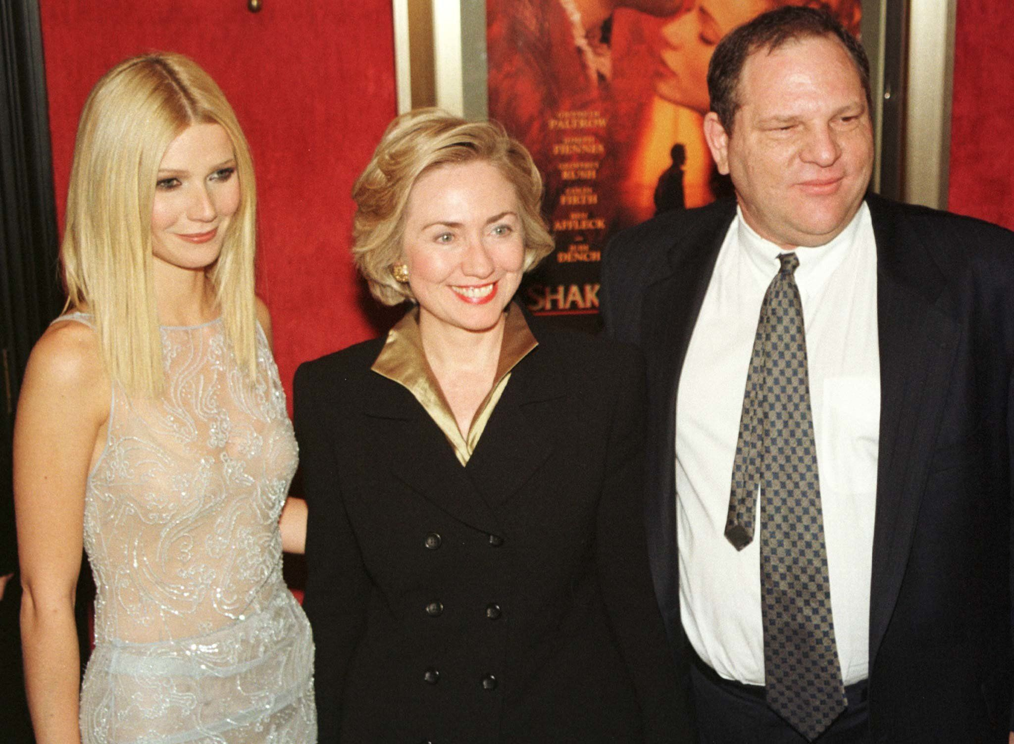 "Actress Gwyneth Paltrow (L) poses with first lady Hillary Rodham Clinton (C) and Miramax co-chairman Harvey Weinstein as they arrive for the premiere of ""Shakespeare in Love"" in New York on December 3. Clinton introduced the film, which stars Paltrow, Joseph Fiennes, and Geoffrey Rush. It opens in New York and Los Angeles on December 11 and nationally on Christmas Day.  PM/ELD"