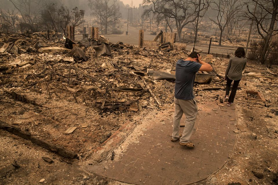 A Fountaingrove Village homeowner reacts as he surveys his destroyed home he has owned for four years in Santa Rosa, Californ