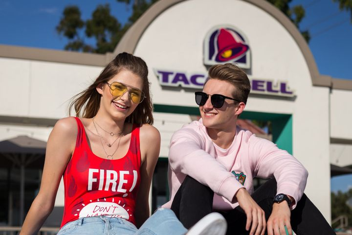 """Models for the new <a href=""""http://www.refinery29.com/2017/09/174135/taco-bell-forever-21-collaboration"""" target=""""_blank"""">Forever 21 x Taco Bell collection</a> include <a href=""""https://www.huffingtonpost.com/entry/teen-gets-her-senior-photos-taken-at-taco-bell_us_55c8a478e4b0f73b20b9d3bb"""" target=""""_blank"""">Brittany Creech</a> and <a href=""""https://www.huffingtonpost.com/entry/taco-bell-senior-portraits_us_5925c86de4b0650cc0213ed2"""">Andrew McBurnie</a>, both of whom <a href=""""https://www.huffingtonpost.com/entry/teen-gets-her-senior-photos-taken-at-taco-bell_us_55c8a478e4b0f73b20b9d3bb"""">famously took their senior portraits</a> at Taco Bell."""