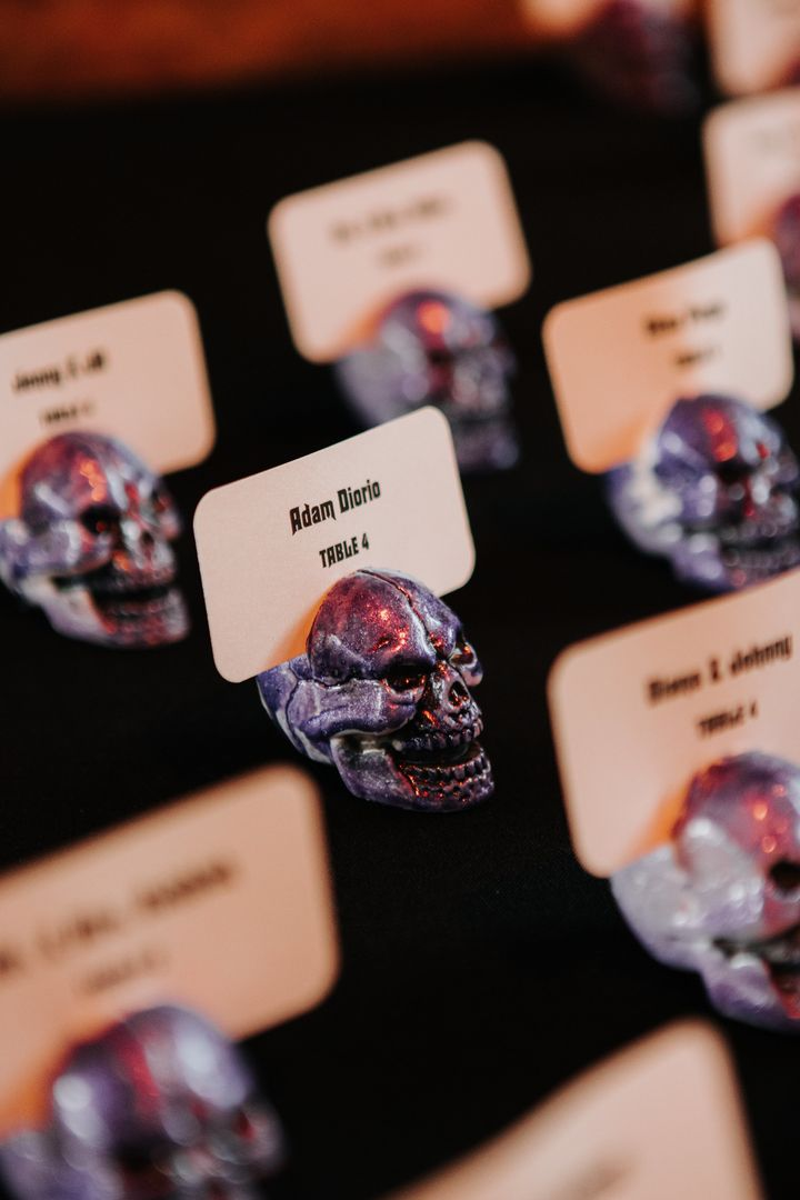 They opted for skull place cards for the October wedding, but the bride said she likes to keep those Halloween vibe