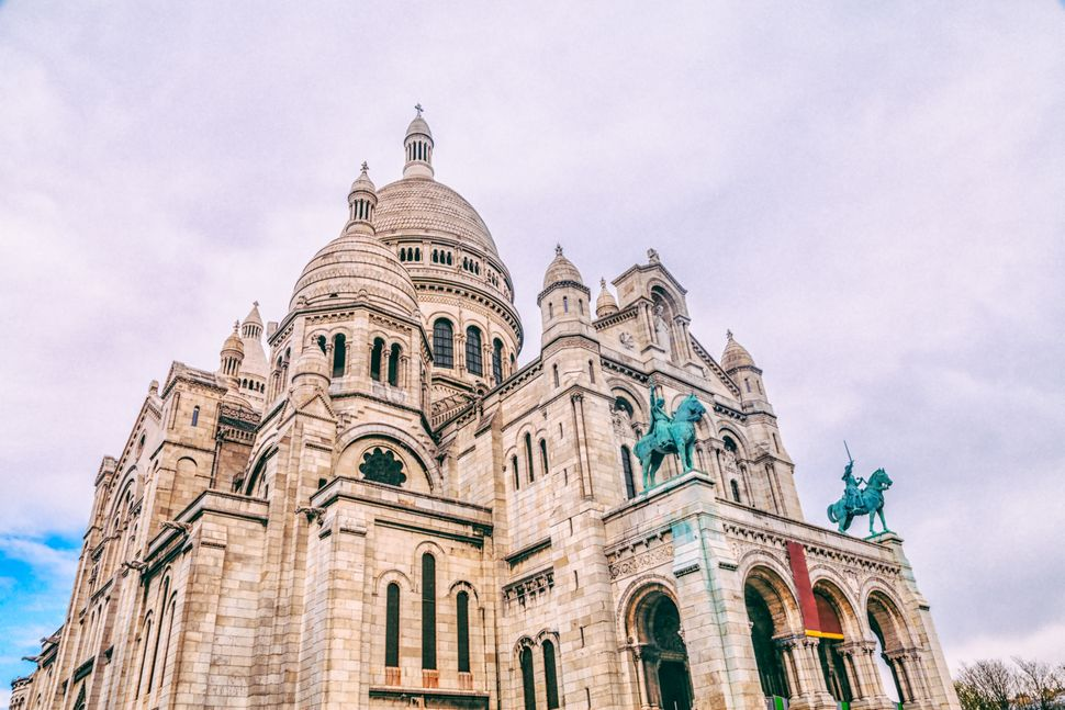 The Sacré-Cœur sits atop the hill of Montmartre, Paris's artistic district. Not only is it one of the most impor