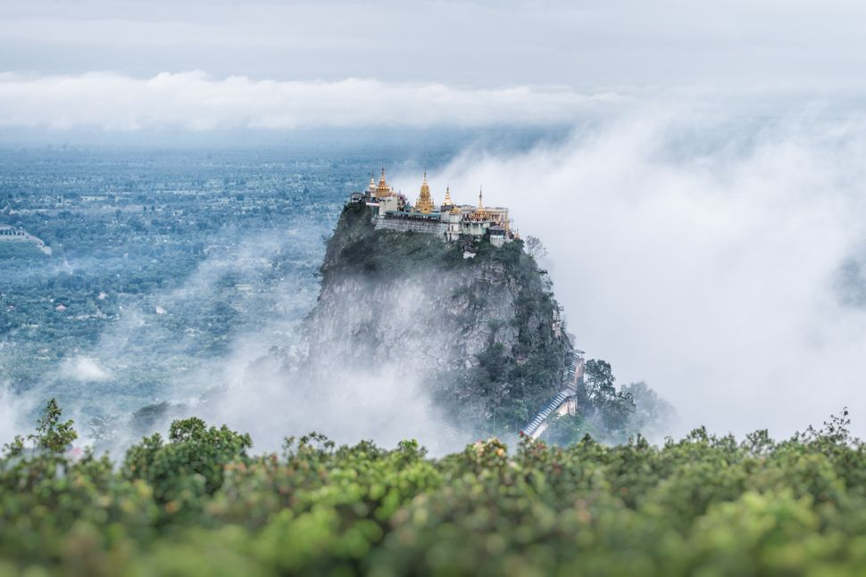Popa Taungkalat Monastery is situated in the shadow of the nearby Mount Popa, a famous pilgrimage site in Myanmar.
