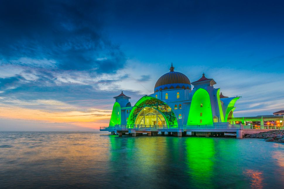 "The Malacca Straits Mosque is located on a man-made island in Malaysia. This gorgeous mosque is also called the ""<a href=""htt"