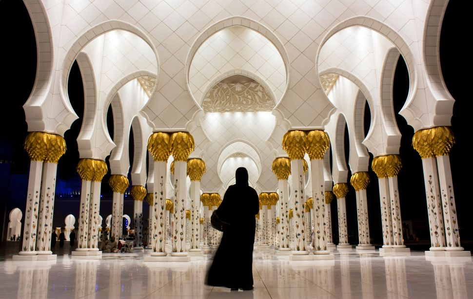 With its sleek white architecture and tranquil reflecting pool, Abu Dhabi's grand mosque stuns day and night. It is the large