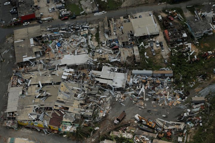 Aluminum roofing is seen twisted and thrown off buildings as recovery efforts continue following Hurricane Maria near San Jos