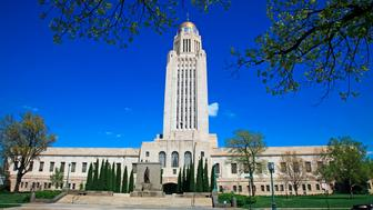 State capitol building in Lincoln Nebraska on a sunny spring day and emphasizing the building's tall central tower and dome, Lincoln, the capital city of Nebraska, is located in the southeastern part of the state along Interstate-80. The state legislature in Nebraska is the only unicameral legislature among all of the states. (Photo by: Education Images/UIG via Getty Images)