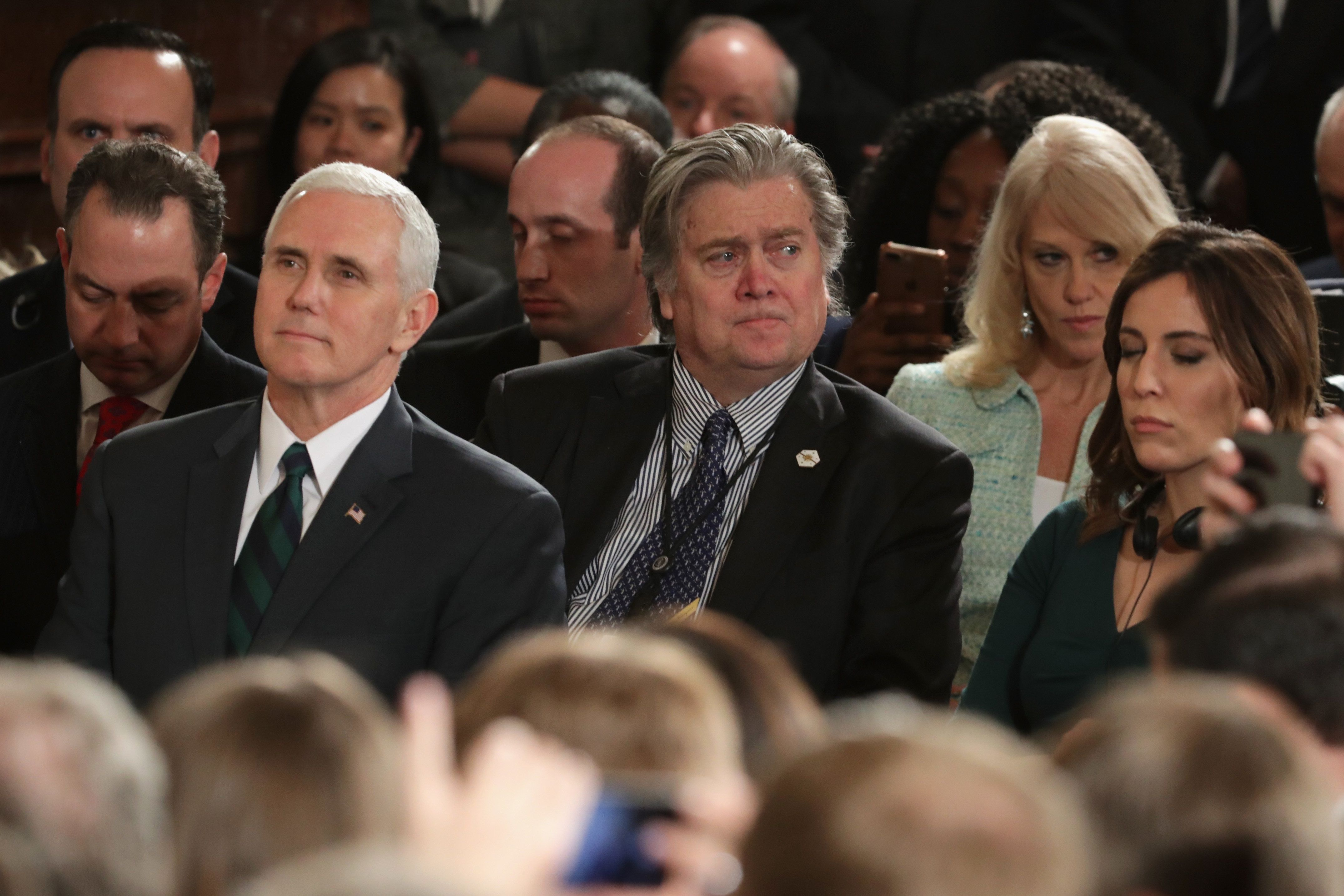 WASHINGTON, DC - MARCH 17: U.S. Vice President Mike Pence (L) and Chief Strategist Steve Bannon (C-R) look on as U.S. President Donald Trump holds a joint press conference with German Chancellor Angela Merkel in the East Room of the White House on March 17, 2017 in Washington, DC. The two leaders discussed strengthening NATO, fighting the Islamic State group, the ongoing conflict in Ukraine and held a roundtable discussion with German business leaders during their first face-to-face meeting.  (Photo by Chip Somodevilla/Getty Images)