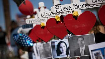 LAS VEGAS, NV - OCTOBER 6: Photographs of the victims are included on some of the 58 white crosses for the victims of Sunday night's mass shooting, on the south end of the Las Vegas Strip, on the south end of the Las Vegas Strip, October 6, 2017 in Las Vegas, Nevada. On October 1, Stephen Paddock opened fire on the crowd killing at least 58 people and injuring more than 450. The massacre is one of the deadliest mass shooting events in U.S. history. (Photo by Drew Angerer/Getty Images)