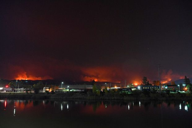 Today, a somber view of fires in the hills illuminating the surrounding area of Atlas Peak Fire in Napa,.